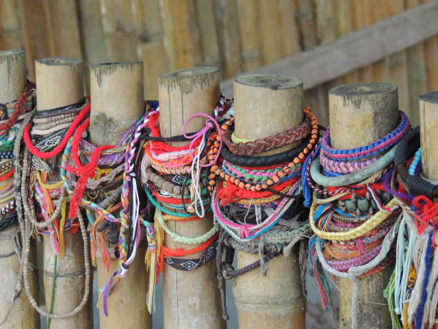 bracelets childrens graves at Choeng Ek Killing Fields Cambodia